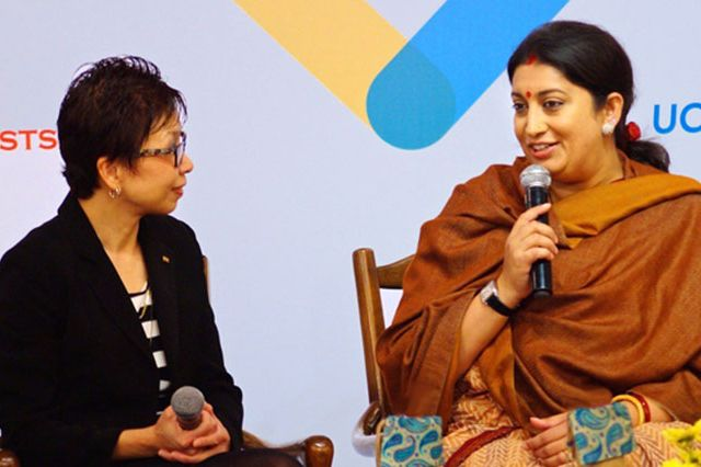 Smriti Zubin Irani, Indian minister of human resource development, speaks with UCLA Vice Provost Cindy Fan at the UCLA-Tata Global Forum held in New Delhi this week.