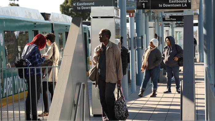 ALS passengers wait to board at the Expo Line Culver City Station.