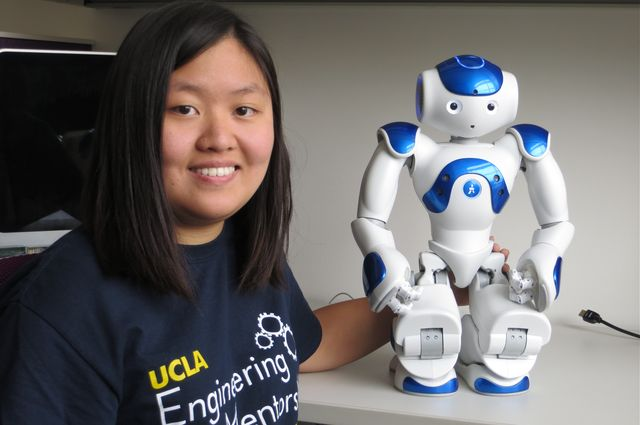 Computer science student Sunnie So with a robot programmed by UCLA researchers to lead exercise routines. The SMART Health Center aims to bring health-focused technology into the home.