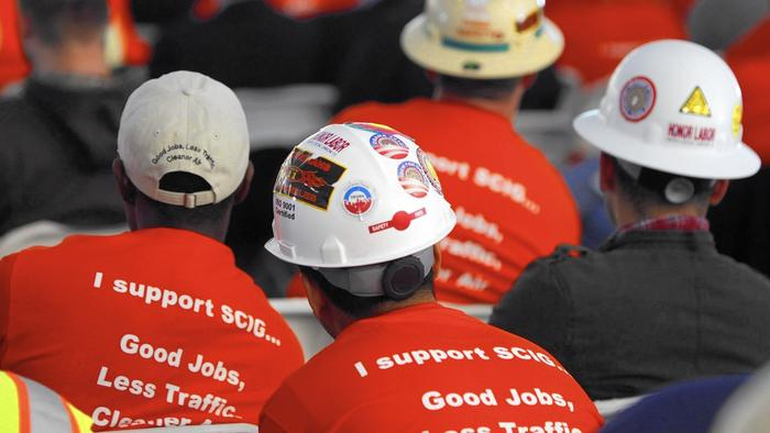 Members of the International Brotherhood of Electrical Workers union show their support for BNSF Railway's proposed Southern California International Gateway (SCIG) facility during a public hearing in San Pedro in 2013.