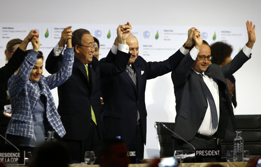 From right, French President Francois Hollande; French foreign minister and president of the COP21, Laurent Fabius; United Nations Secretary General Ban ki-Moon; and United Nations climate chief Christiana Figueres hold hands after the conference on climate change, in Le Bourget, France—north of Paris—on Saturday, Dec.12, 2015.