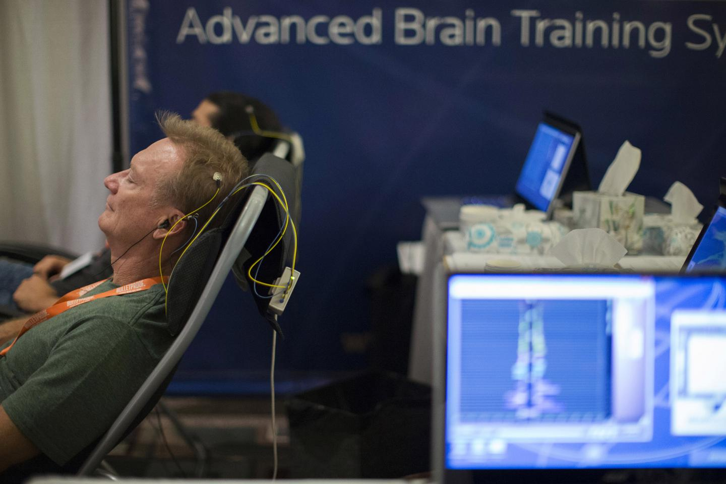 An attendee takes part in a neurofeedback session during the opening day of the second annual Bulletproof Biohacking Conference at the Pasadena Convention Center in California on September 26, 2014. Neurofeedback uses real-time displays of brain activity to teach the brain to self-regulate, a technique neurologists have wielded since the 1960s.