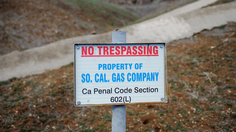 A sign declares the boundary line of the Southern California Gas Company gas fields at Aliso Canyon.