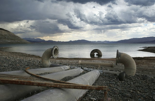 Water intake pipes that were once underwater sit above the water line along Lake Mead in the Lake Mead National Recreation Area near Boulder City, Nevada. This photograph was taken on May 18, 2015. The lake hit a record low in May 2016.