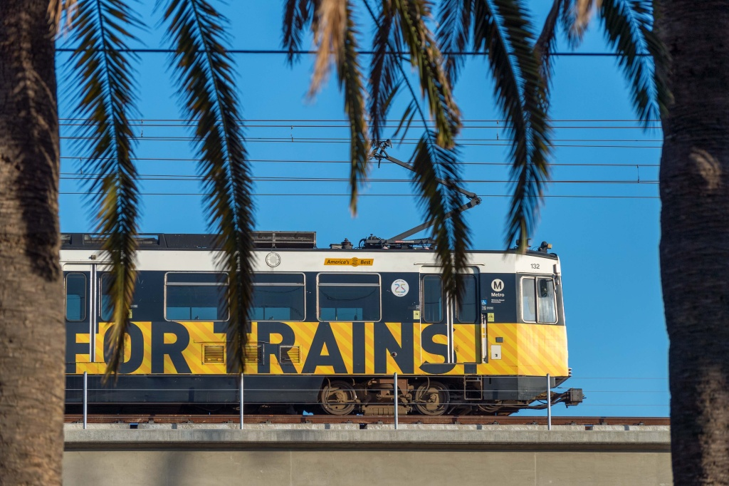 A test train runs above Pico Boulevard in Santa Monica along the new Expo Line extension on April 27, 2016. A Metro ballot measure would increase a county sales tax to pay for more new rail, bus and highway improvements.