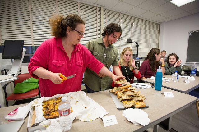 Evan Kleiman's students take a break from serious discussions about food issues to enjoy a focaccia pizza she made. Sharing food and recipes is an essential part of the course.