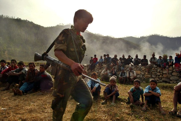 A young Maoist soldier walks into a village in Kholagaun, Nepal, in 2004