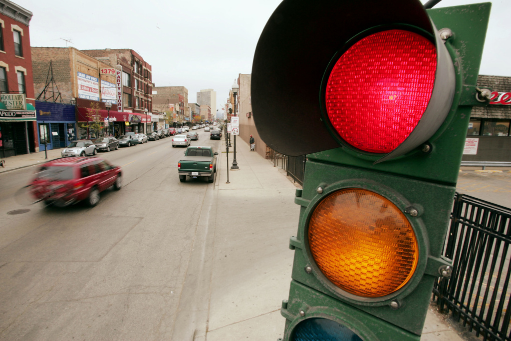 A traffic light controls the flow of vehicles and pedestrians near downtown Chicago, Illinois.