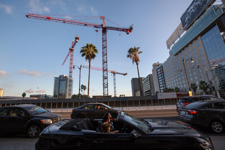 Construction cranes above Hollywood Boulevard in Los Angeles. A building boom in mixed-use developments, luxury hotels, shopping centers and high-rise condominiums is spreading across the city.