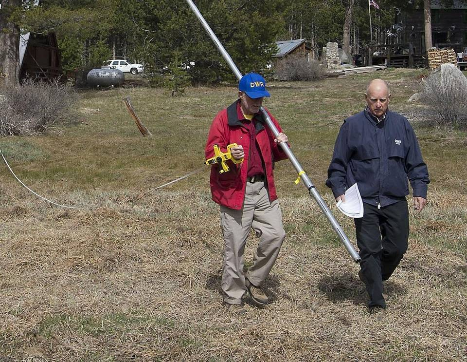 Gov. Jerry Brown, right, walks into a snowless meadow during the 2015 snowpack survey. The lack of snow bolstered the governor's case for water conservation. Read more here: http://www.sacbee.com/news/state/california/water-and-drought/article104812236.html#storylink=cpy